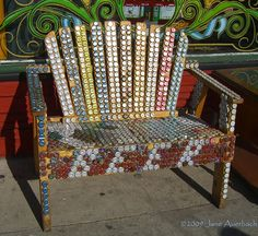 A delightful chair decorated with beer caps
