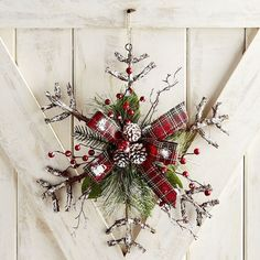 Snowflake instead of a wreath...Love it!!!   Surprise your guests with this adorable snowflake wreath rather than the traditional circle.  #winter #Christmas #afflink