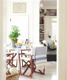 knoll saarinen table and directors chairs in kitchen- baskets with straw hats for easy access near doors to terrace