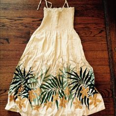 "Hawaiian Sundress Light sundress with beautiful Hawaiian print details.  Color is a butter yellow/cream.  Made in Hawaii.  33"" from armpit to bottom hem.  Size on tag is not accurate.  This will fit sizes XS to M.  Top has lots of stretch. Dresses Midi"