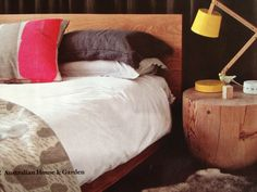 Wooden bedhead, but particularly like these rustic bedside tables