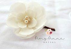 This stunning wedding bobby pin has an ivory chiffon flower with slightly turned edges. This piece is embellished with a hand sewn pearl beads.  This flower is approximately 2 1/4 inches in diameter. This piece can be made larger or smaller based on your preference.   We specialize in custom orders, especially for weddings, and enjoy doing them. Please just ask me if I can work with your colors, the number of pieces you need, etc. I am always happy to discount multiple orders of an item....