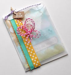 Twine and mini clothespin to close envelope looks cute.