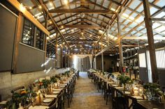 Such an ideal venue for our Farm Tables. We love what Bloomfield Events did to make these tables look perfect for this barn wedding at Bloomfield Farms! #encoreeventsrentals #barnwedding #farmtables Photography: Suzanne Karp