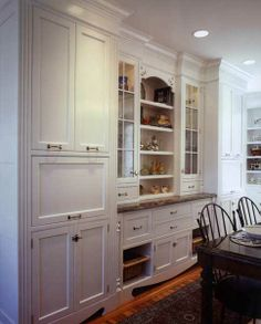Something like this built-in along one wall in the formal dining room would be wonderful.  But I see it in cherry wood or mahogany to match a formal dining set.  So far, anyway.