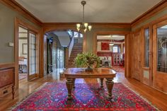 54 Janssen Place front entrance. Original woodwork and hardwood floors throughout, with tile and marble accents.