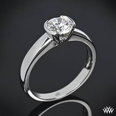 """Named after the crucial element used to create a strong and lasting bond, the """"Keystone"""" Half-Bezel Solitaire Engagement Ring signifies the relationship your love share. The beautiful half-bezel design securely cradles your diamond and allows for maximum exposure. The width tapers from 3.3mm at the top down to 2.5mm at the bottom.  Select your diamond from our extensive online diamond inventory. Please allow 10 business days for completion.  If you require this ring sooner please contact one…"""