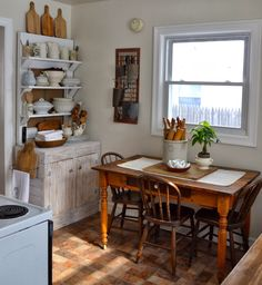 Shabby Love   ideas for displaying in our booth...shelves ( or a cupboard) for ironstone/cutting boards/dishes.  Grate on wall is great memo board.