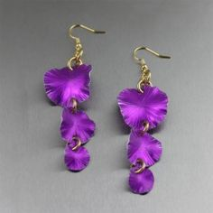 Three Tiered Violet Anodized Aluminum Lily Pad Earrings - Dramatic Violet Anodized Aluminum is the star attraction in these exquisite lightweight Lily Pad Earrings. They make a unique and memorable jewelry accent appropriate for most any occasion. For a Complementary color pairing, wear them with your favorite Yellow blouse, or with Orange and Green for Triadic palate.