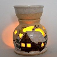 Handmade ceramic oil burner with a house in snow. A fab gift for only £24. Available in our online gift shop www.purrfect-ceramics.co.uk