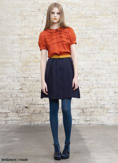 orange blouse and navy skirt