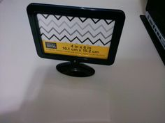 Make your doll a Flat screen TV with stand using this 2.00 item from Michaels. Just print off your favorite show and slide in instead of photo.