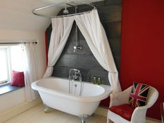 Luxury bathroom with rolltop bath and rainhead shower over. The Old Swan Inn - Holiday Cottage. www.the-oldswaninn.co.uk