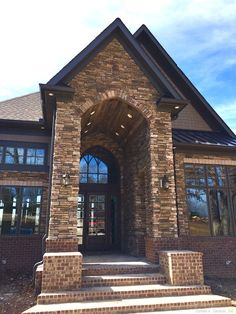 Rear photo of Plan   The Riva Ridge   Donald A  Gardner House    Arched stone and brick front entry to The Jasper Hill  plan   http