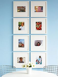 A symmetrical configuration of frames creates a striking yet simple focal point in a room.