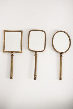 set of 3 hand mirrors with brass handles  $49.00
