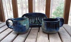 Laguna Navy Blue & Robin's Egg Blue on Black Clay, 2 Mugs & a spoon dish $95  Pottery is the craft, Glazing is my Art. Blue Coffee Mugs, Coffee Mug Sets, Mugs Set, Black Clay, The Potter's Wheel, Stoneware, Glaze, Spoon, Egg