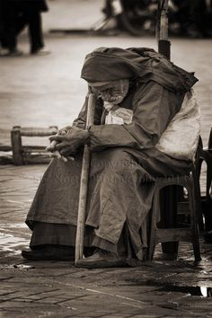 Traditionally dressed old Moroccan man in Marrakech, Morocco. Sepia fine art photograph. $30.00, via Etsy.