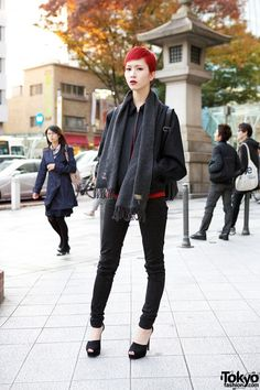 Yuho is a striking 18-year-old model who caught our eye on the street in #Harajuku. Her look includes a short red #hairstyle, a Comme des Garcons jacket, Uniqlo skinny jeans & peep toe heels. More pics here! #black #tokyofashion