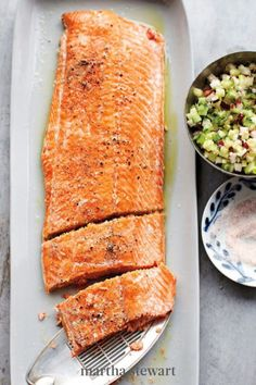 Roasting a whole side of salmon is such a fast and easy way to feed a large crew. Case in point? This dish serves eight and cooks in the oven in just ten minutes. A crunchy cucumber and radish relish has a slight bite of spring horseradish which goes well with the fish. #marthastewart #recipes #recipeideas #easterfood #easterrecipes #eastertreats #easterideas Relish Recipes, Roasted Salmon, Baked Salmon, Grilled Salmon, Shellfish Recipes, Seafood Recipes, Easter Main Dishes, Great Recipes, Gastronomia