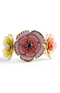my inner 12-year-old is completely smitten with this hinged bangle.
