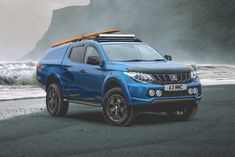 The Surf Titan Concept from is next up for the It features a sloping hardtop with mounts for securing surfboards and roof mounted light bar for the adventurer in you. Mitsubishi Truck, Mitsubishi Motors, Outlander Phev, Surfboards, Adventurer, Electric Cars, Bar Lighting, Pickup Trucks, Jeeps