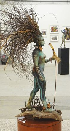.this is such an interesting piece... I can't stop looking. How wonderful is that hair do!