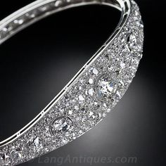 French Art Deco Diamond Bangle Bracelet, circa 1925, features three central European-cut diamonds nestled amid 168 tightly-packed, old-European, old-mine and Swiss-cut diamonds - totaling 14.00 carats.