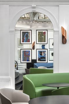 gorgeous art hung on a stunning mirror.  brilliant.
