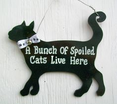 Funny Cat Sign A Bunch Of Spoiled Cats Live Here. $7.50, via Etsy.