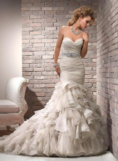 Maggie Sottero Divina: buy this dress for a fraction of the salon price on PreOwnedWeddingDresses.com