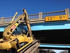 NILES, MI – On Thursday, March 12th, 2015, a semi was driving north on M-51 south of Niles, Berrien County. While attempting to drive under US-12, the load, an excavating machine, became lodged under the bridge.