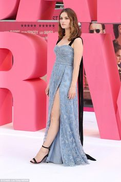 Glamour: The actress oozed glamour in the figure-hugging baby blue Burberry dress which bo...
