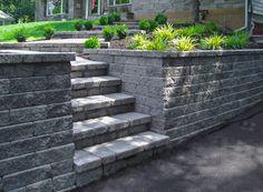 Interlocking concrete block retaining wall