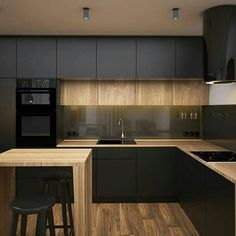 Dark kitchen, wood materials, units to the ceiling