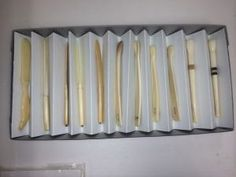 Accordion-folded paper is a quick divider in a tray.
