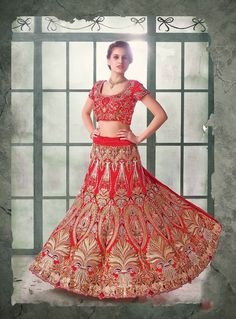 Exclusive red net and silk Indian lehenga choli with embroidery. An elegant piece for special occasions like wedding, reception, cocktail party and daytime functions.
