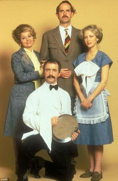Iconic: John as Basil with co-stars Prunella Scales as Sybil Fawlty, Andrew Sachs as Manuel and Connie Booth as Polly Sherman in the original Seventies series British Tv Comedies, Classic Comedies, British Comedy, British Actors, English Comedy, British Celebrities, Comedy Actors, Comedy Show, Actors & Actresses