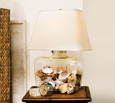DIY keepsake lamp: Clear counter space and create keepsake items in one move! Transparent glass lamp bases and boxes are great for making a statement memory item with those small items that usually live in a drawer or clutter up a side table. Fillable Lamp, Seashell Display, Shell Lamp, Jar Lamp, Glass Table, Lamp Design, Coastal Decor, Pottery Barn, Sea Shells