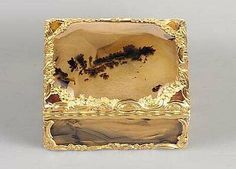 an English hardstone snuff box with chased gold cagework mounts, circa 1765  (photo: courtesy of Sotheby's)