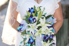 Orchids and lilies in a stunning bouquet