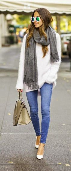 Fluffy sweater, jeans, scarf and bag. Latest fashion trends 2015.: