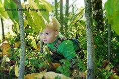 2 year old boy photo in John Deere camo in the woods Johnson Branch Photography