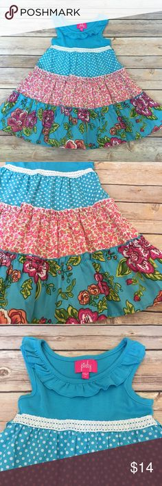 Pinky Dress Size 3, Pinky brand dress. Bright blue with three layer twirl skirt. Ties in the back. Bright colors. Very minimal amount of washer wear/pilling on the top part of the dress. Very good used condition. Pinky Dresses Casual