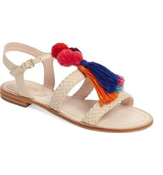 Tassels & pompoms liven up this soon-to-be essential pair of flat sandals. Hello summer!