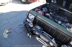 We met this Jeep owner at SEMA, where he told us he had to change battery brands, because his OPTIMA battery wouldn't hold a charge in his Jeep. Thirty minutes later, he came back, asking for a jump, because his new battery wouldn't hold a charge either. We jump-started his transplanted LS engine with one of our Prius batteries. Time to start looking for a third battery brand or a parasitic draw. We suggested the latter.