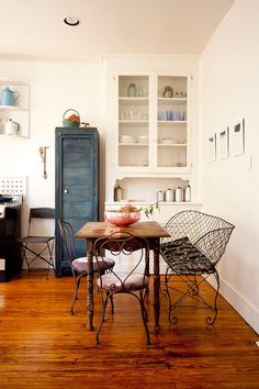 Repainted vintage cabinet, reclaimed decor and fabulous furniture shape the smart dining room [From: Chris Dorsey Photography]