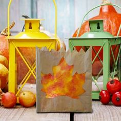Create a cute fall lantern of a paper lunch bag and coffee filters! Add a subtle glow with an LED tea light!