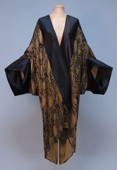 Paris Label Silk and Lame Cocoon Style Evening Coat c. Black satin with gold stylized rose pattern, wide satin bands at front and sleeve hem, single satin tie, lined in pale gold chiffon. 20s Fashion, Kimono Fashion, Fashion History, Art Deco Fashion, Retro Fashion, Vintage Fashion, Womens Fashion, Fashion Design, Vintage Coat