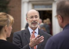 Pennsylvania Governor Tom Wolf greeted visitors to the Governor's Residence holiday decoration display on Sunday, December 13, 2015.  Daniel Zampogna, PennLive